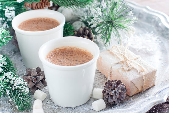 Hot chocolate in white glasses on a tray with New Year's decor, horizontal, copy space