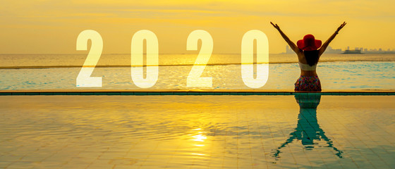 Poster de jardin Spa Lifestyle woman Happy New Year Card 2020. Silhouette woman relaxing and freedom on the swimming pool near the sea and beach in the sunset as part of Number 2020. Summer and Holiday Concept