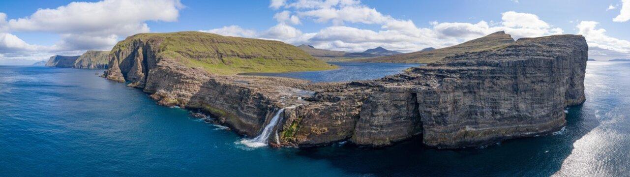 Leitisvatn lake and Bosdalafossur waterfall on Vagar island aerial view, Faroe Islands 32:9