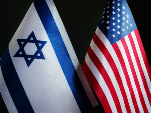 Flags of the USA and Israel in the dark.