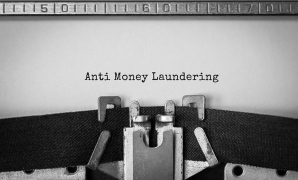Text Anti Money Laundering typed on retro typewriter