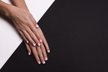 Deurstickers Manicure Beautiful hands with french manicure on black background