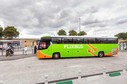 30 july 2019, France, Charles de Gaulle airport: Flixbus arrives at bus stop. Passengers boarding