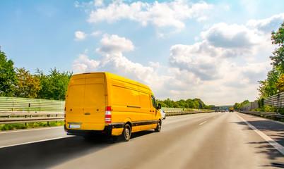 Yellow Car on highway in summer - fototapety na wymiar