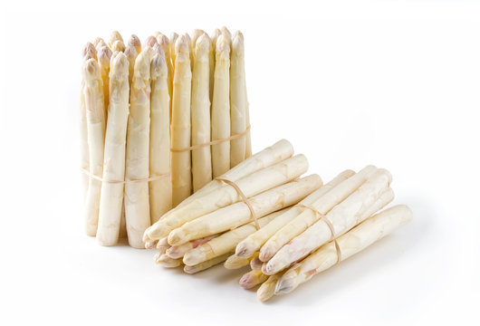 Raw white Asparagus with violet head as bunch as close-up with copy space – isolated on white background