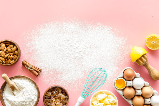 Baking mockup. Dough ingredients on pink background top view space for text
