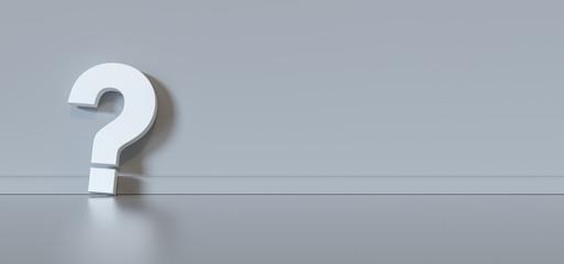 Fragezeichen vor grauer Wand mit Textfreiraum