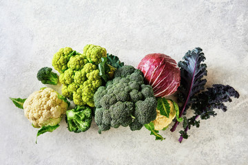 Cabbage of different varieties on a light background