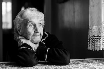 Close-up portrait of an elderly meloncholic woman.