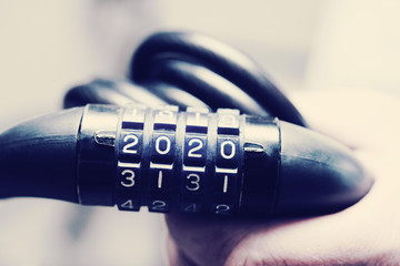 2020 numbers on the code lock, combination lock for the bike, toned. Conceptual Image of the coming new year.