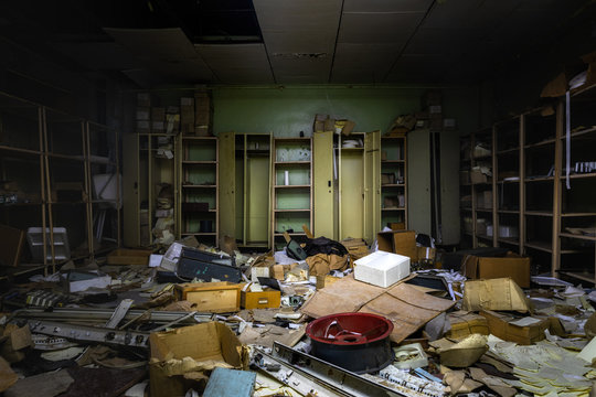 Messy room in abandoned building with lot of junk