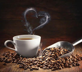 Coffee cup and coffee beans with bag, scoop and steam