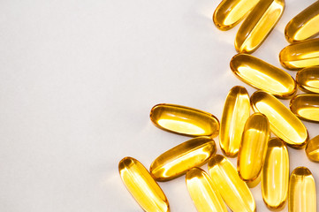 Close up of food supplement oil filled capsules suitable for: fish oil, omega 3, omega 6, omega 9,...