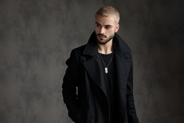 attractive fashion model wearing black longcoat
