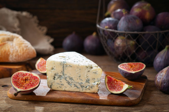 blue cheese with fresh figs on wooden board