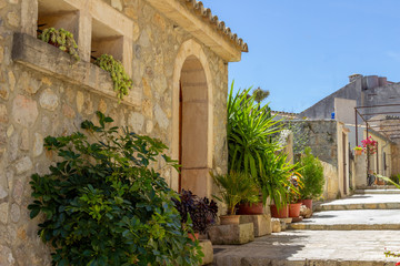 Small road and house in the village Campanet in the north of Mallorca
