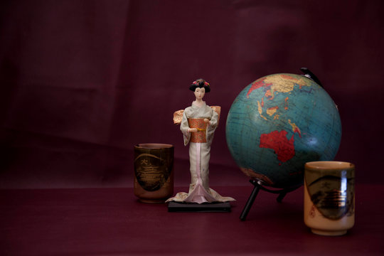 Geisha doll and clay cup & old globe