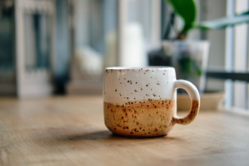 Scandinavian style ceramic cup on wooden table