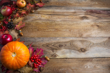 Thanksgiving  or fall greeting background with orange pumpkins and fall leaves