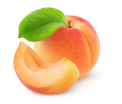 Isolated apricot. One whole fresh apricot with leaf and a cut piece isolated over white background with clipping path