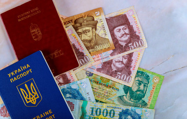 The Hungarian passports and Ukrainian passport with money banknotes forints