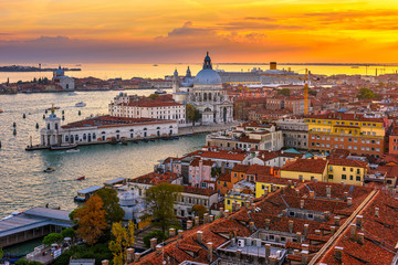 Wall Mural - Aerial sunset view of Venice, Grand Canal and Basilica di Santa Maria della Salute in Venice, Italy. Architecture and landmarks of Venice. Venice postcard