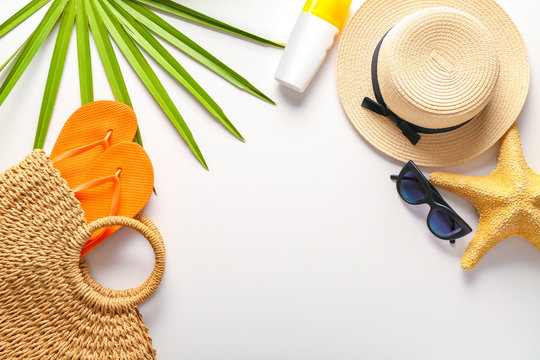 Summer composition with beach accessories on white background