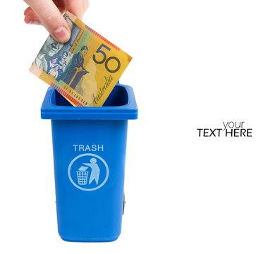 Australian money in the garbage bin
