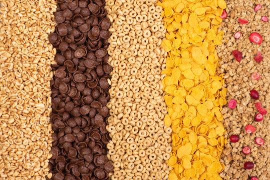 Various breakfast cereals background, top view