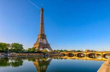 Wall Mural - View of Eiffel Tower and river Seine at sunrise in Paris, France. Eiffel Tower is one of the most iconic landmarks of Paris