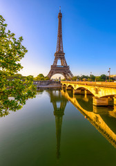 Fotomurales - View of Eiffel Tower and river Seine at sunrise in Paris, France. Eiffel Tower is one of the most iconic landmarks of Paris