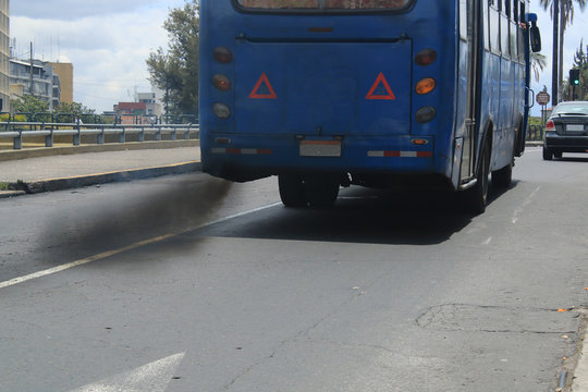 An auto bus polluting the environment with black smog coming from the exhaust pipe