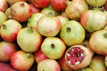 Wall Mural - fresh pomegranate in pile as food background