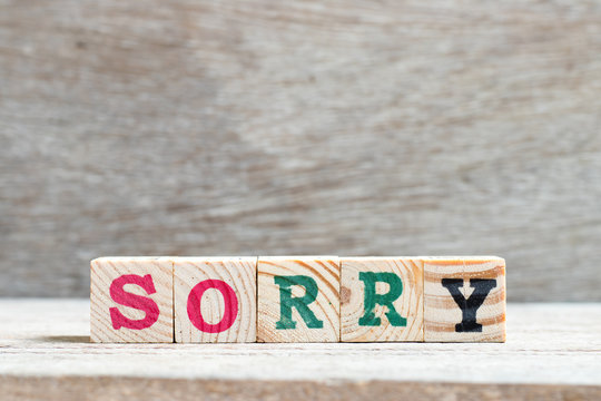 Letter block in word sorry on wood background
