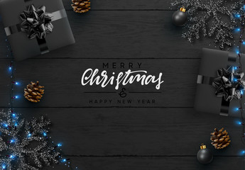 Christmas background. Wood plank texture, black snowflakes are strewn with sparkles, realistic pine cone, decorative baubles, gift boxes, xmas bright light blue garland. Merry Christmas Happy New Year