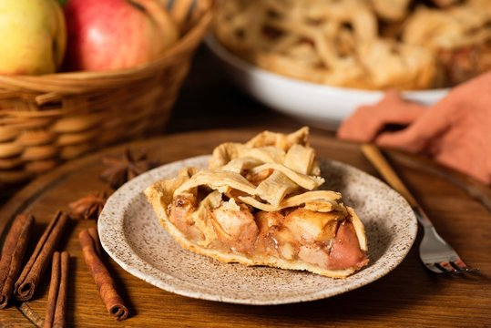 Slice of homemade apple pie with cinnamon. Closeup view. Autumn comfort food, traditional classical american dessert