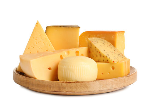 Wooden plate with different kinds of cheese on white background