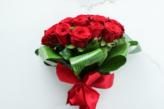 Holiday love present on Valentines Day, luxury bouquet of red roses