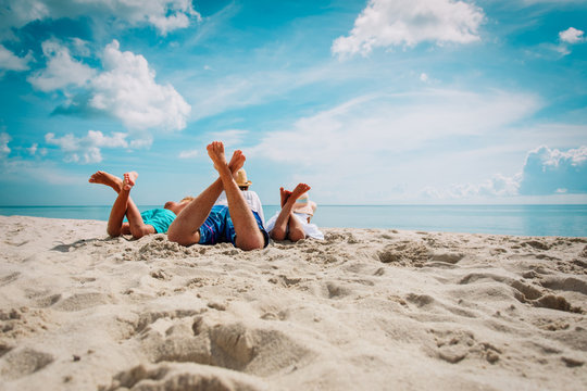 father with son and daughter relax on beach