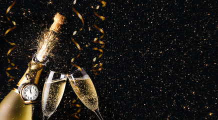 New year party concept with a exploding champagne bottle
