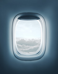 airplane window with clouds view