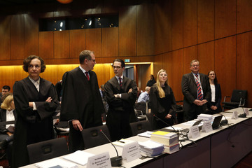 Lawyers prepare before the start of a hearing over the VW diesel emissions cheating scandal, in Braunschweig