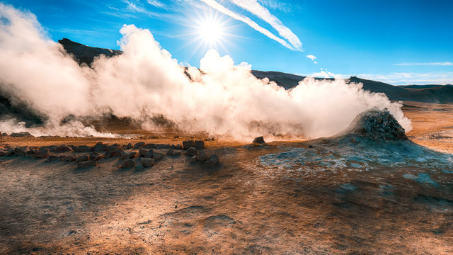 Steaming cone in Hverir geothermal area with boiling mudpools and steaming fumaroles in Iceland