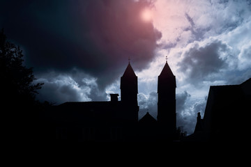 Fotobehang Kasteel Silhouette of medieval castle and the cathedral church, night over dark sky background with the full moon