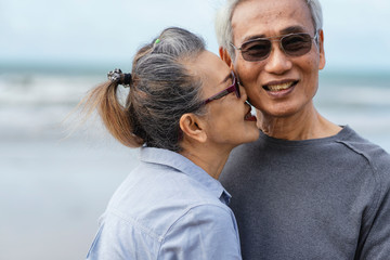 Asian couple senior elder retire resting relax walking running at the beach.Honeymoon family together happiness people lifestyle.Mature couples relax at the seaside on holiday.