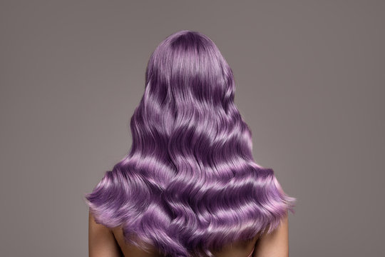 Perfect long wavy violet hair. View from behind.