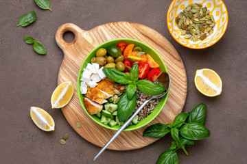 Greek inspired buddha bowl with grilled chiken breast