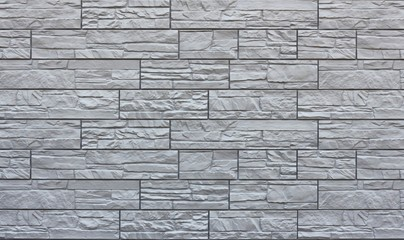 Grey stone tile texture. Gray brick wall. Close up