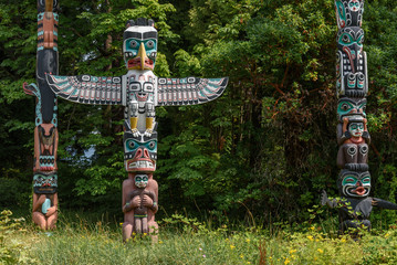 Totem poles located in a clearing of a forest
