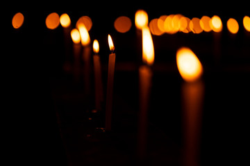 Beautiful Burning Candles Decoration On Diwali. Burning candles with shallow depth of field candlelight background image for diwali festive decoration or church celebration at night with copy space.